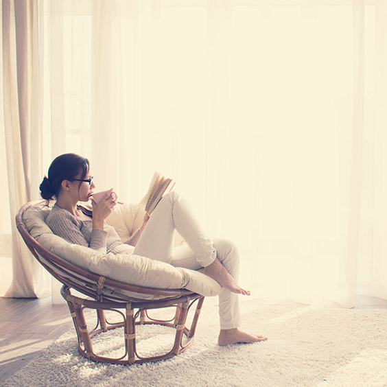 Image of woman relaxing in a lagom scandinavian style