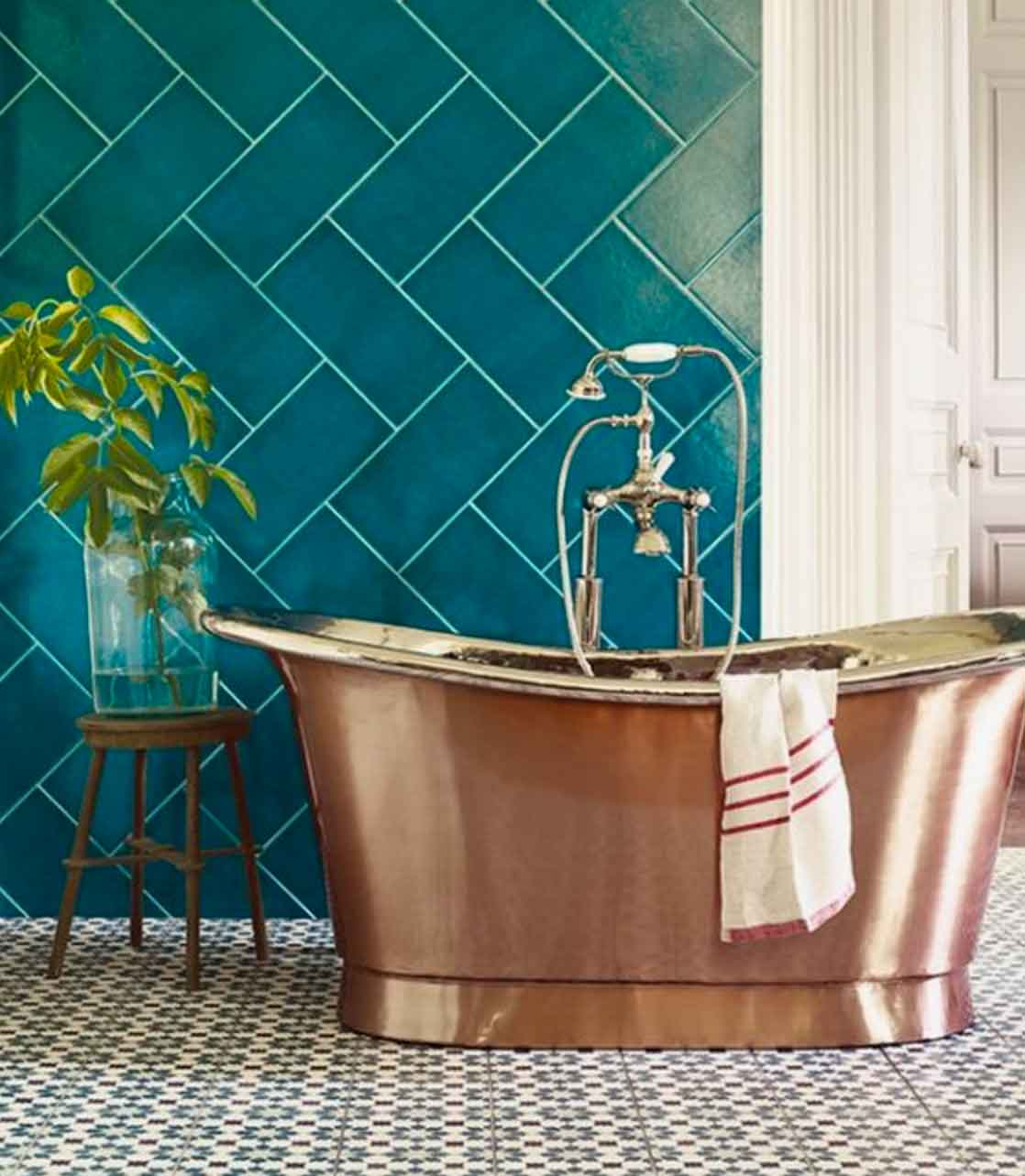 Image of a Luxurious copper bath from Fired Earth in a blog post about bathroom decor ideas by forthefloorandmore.com