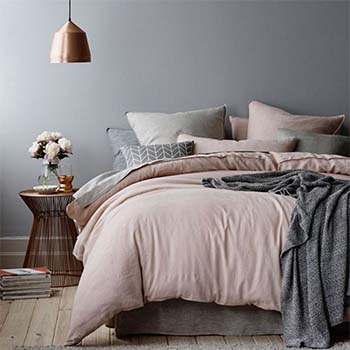 Photograph of Autumn cool bedroom pinks and greys - Image in a blog post by forthefloorandmore.com