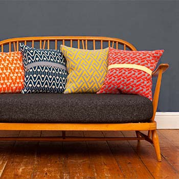 Image of colourful geometric cushions in a blog post by forthefloorandmore.com