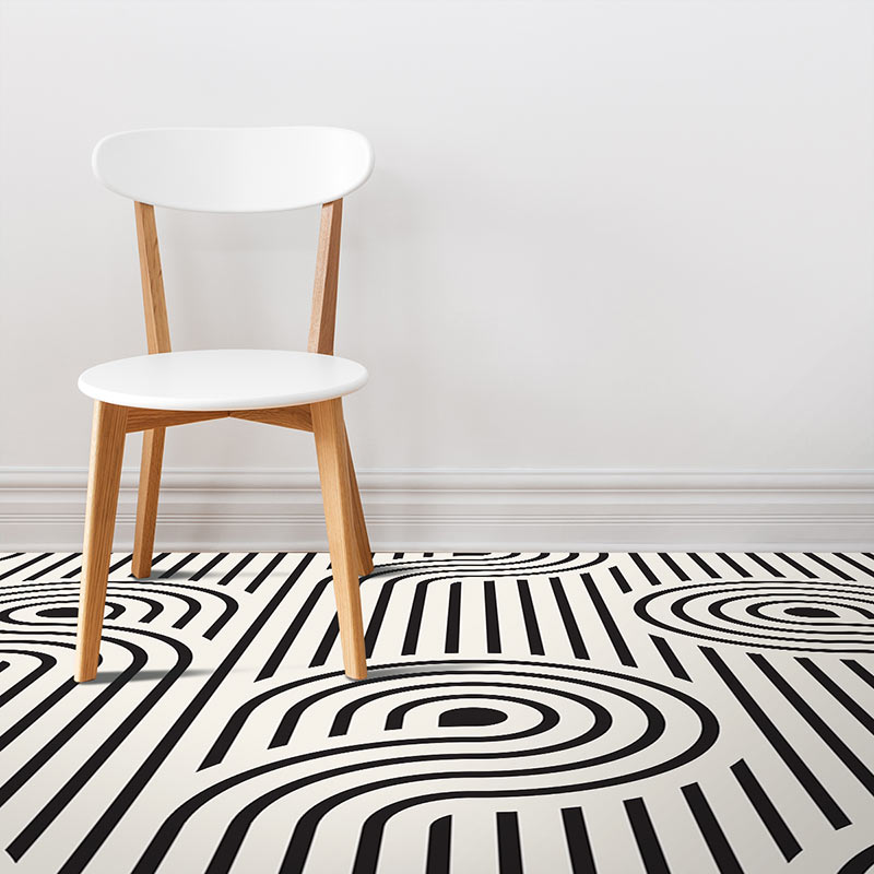 Image of Atik geometric home decor pattern printed as modern black and white vinyl flooring from forthefloorandmore.com