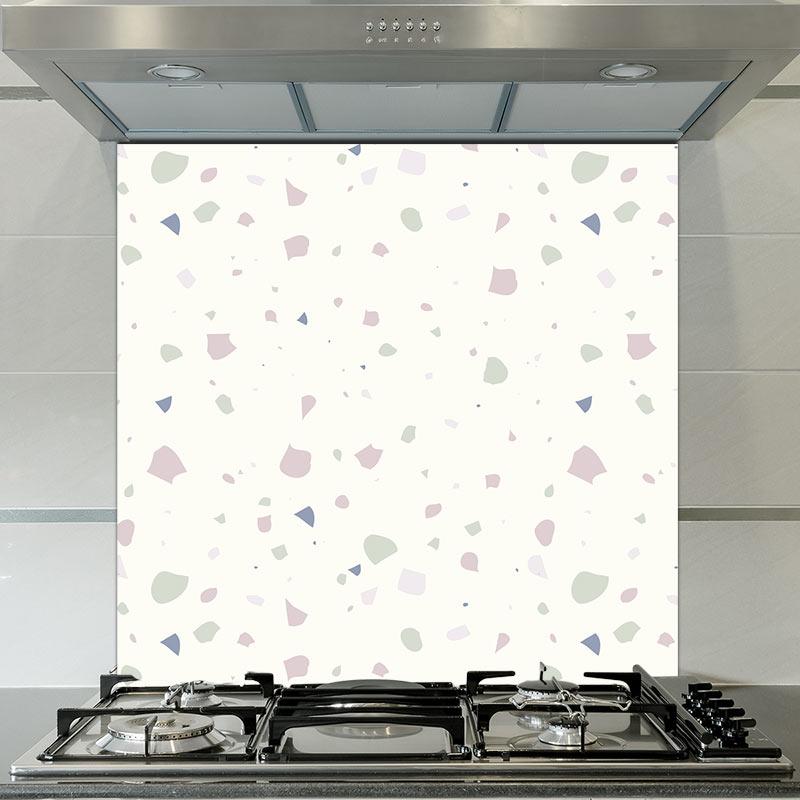 Image of Noemi terrazzo style Italian tile patterned glass splashback design by forthefloorandmore.com