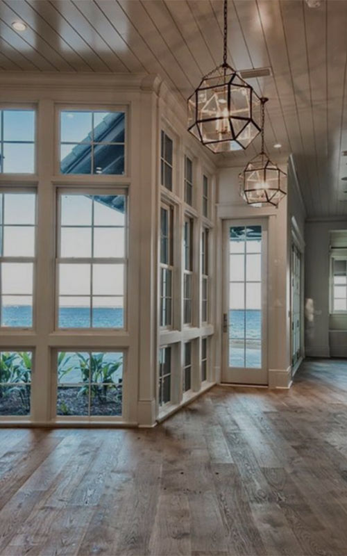 Image of a Beautiful natural wood floor sun room used in a blog post by forthefloorandmore.com