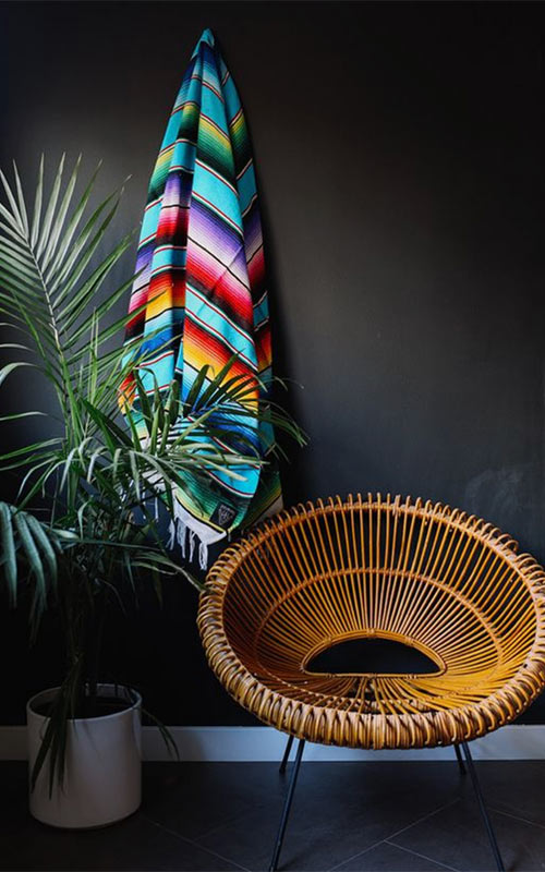 Image of Oudoorsy rattan style chair used in a blog post about bringing the summer inside from forthefloorandmore.com