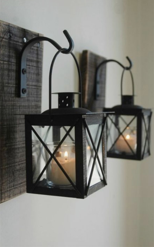 Image of Rustic wall lanterns used in a blog post by forthefloorandmore.com