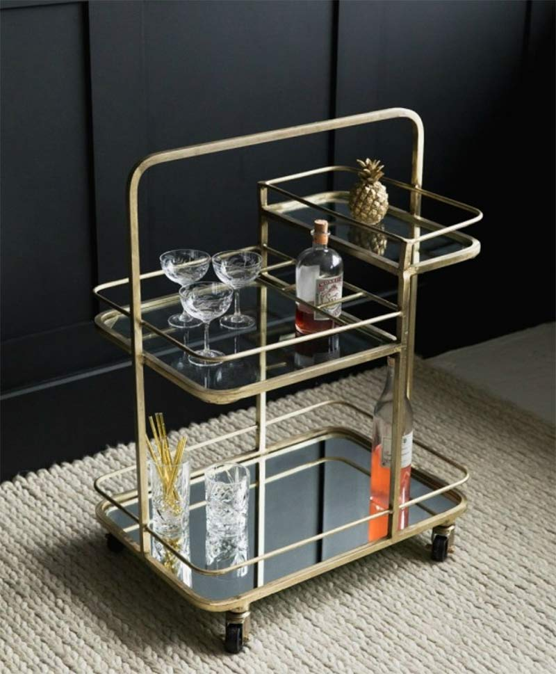 Image of a totally on-trend bar trolley used in a blog post about the home decor trends for 2019 by forthefloorandmore.com