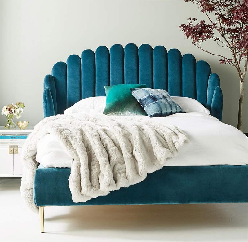 Image of a curvy wavy bed used in a blog post about 2019 home decor trends by forthefloorandmore.com