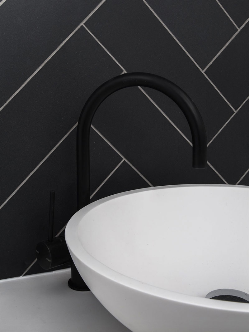 Image of matte black taps and tiles used in a blog post about home decor trends for 2019 by forthefloorandmore.com