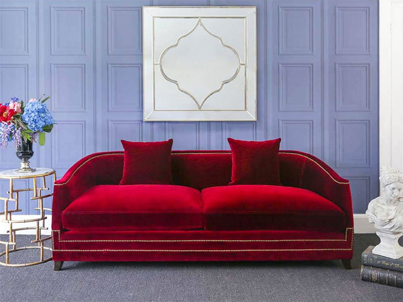 Image of a 2019 on-trend velvet sofa used in a blog post about 2019 home decor trends by For the Floor and More
