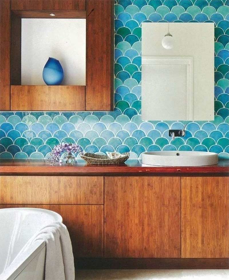 Image showing blue fish scale tiles used in a blog post about meramid tile flooring and splashbacks by forthefloorandmore.com