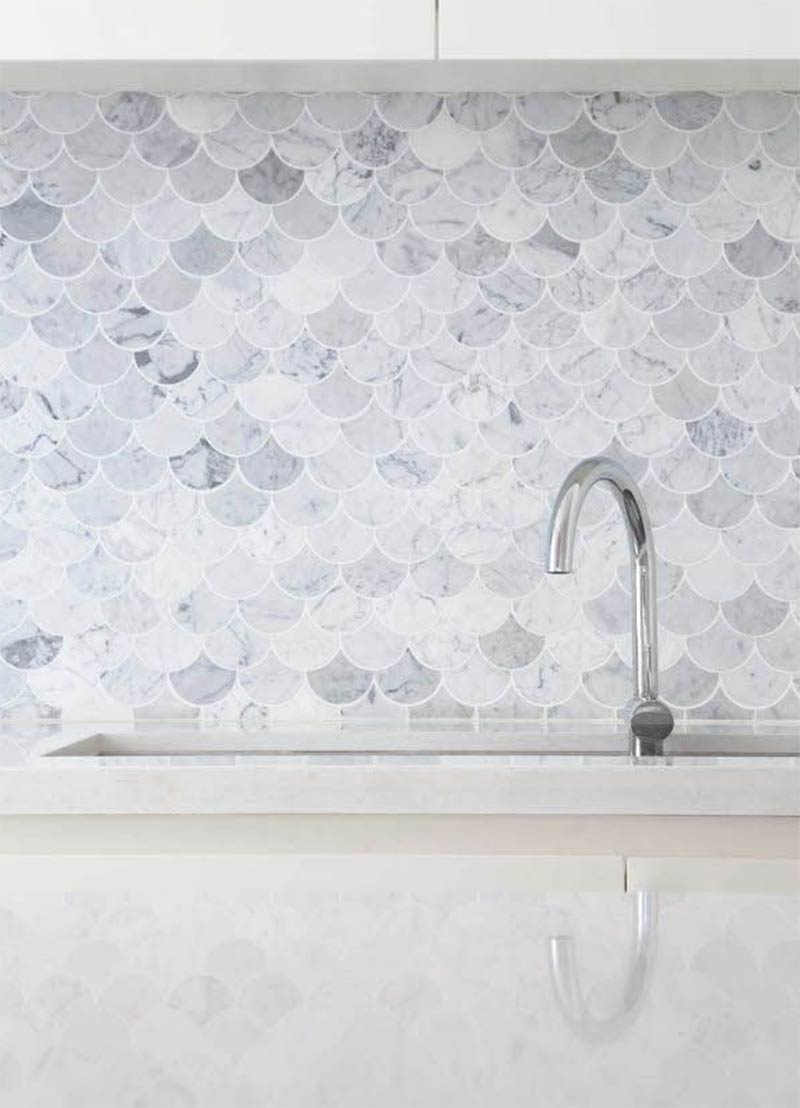 Image showing pastel coloured fish scale tiles used in a blog post about on-trend scalloped mermaid tiles by forthefloorandmore.com