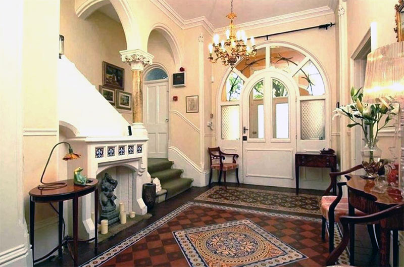 Image of Victorian home decor showing Minton tiles, cornicing, and high ceilings
