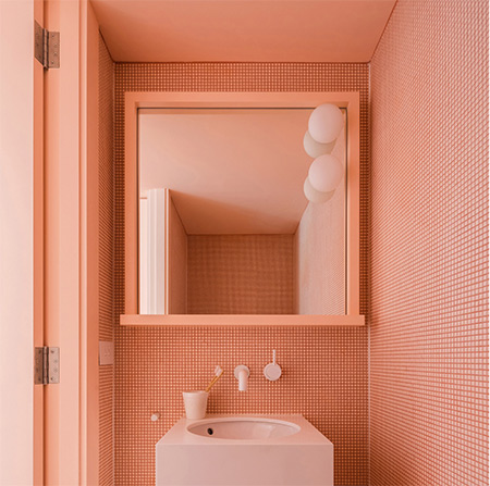 Image showing a bathroom using the Pantone colour Living Coral from a blog post about pastel flooring from forthefloorandmore.com