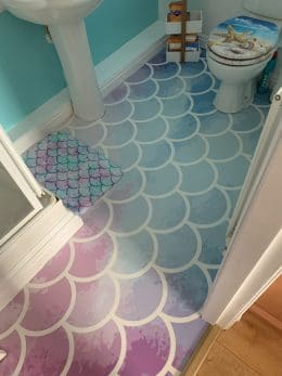 Image of a custom mermaid tile flooring by For the Floor and More