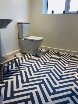 Image of a custom Herringbone patterned vinyl flooring from a customer review of forthefloorandmore.com