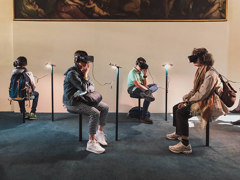 Image showing people sitting around not talking all on VR headsets