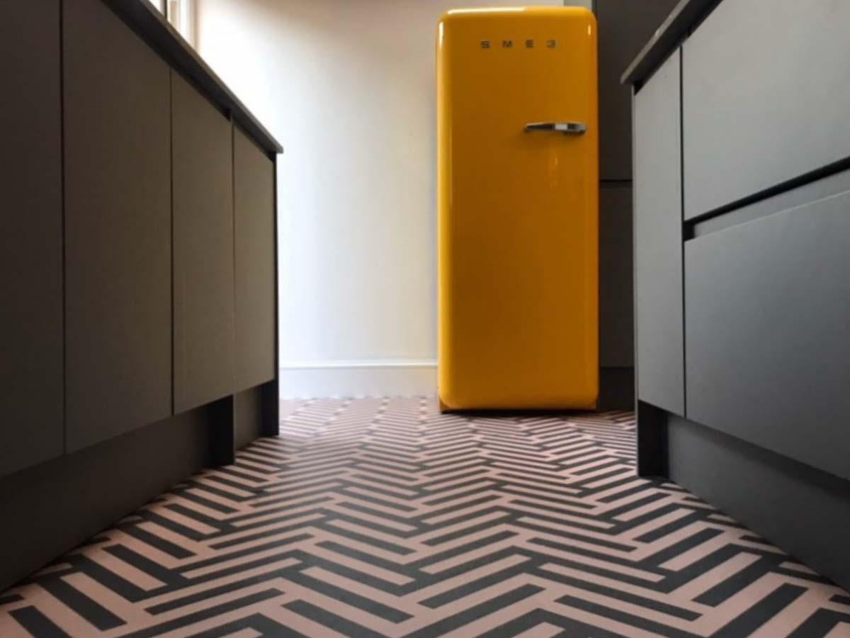 Customer photo testimonial of our Herringbone Pink patterned vinyl flooring from a customer review of forthefloorandmore.com