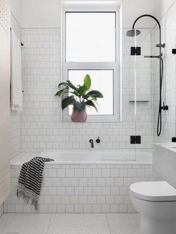 Image showing a tiled bathroom from Pinterest used in a blog post by forthefloorandmore.com about imitation tile floorings