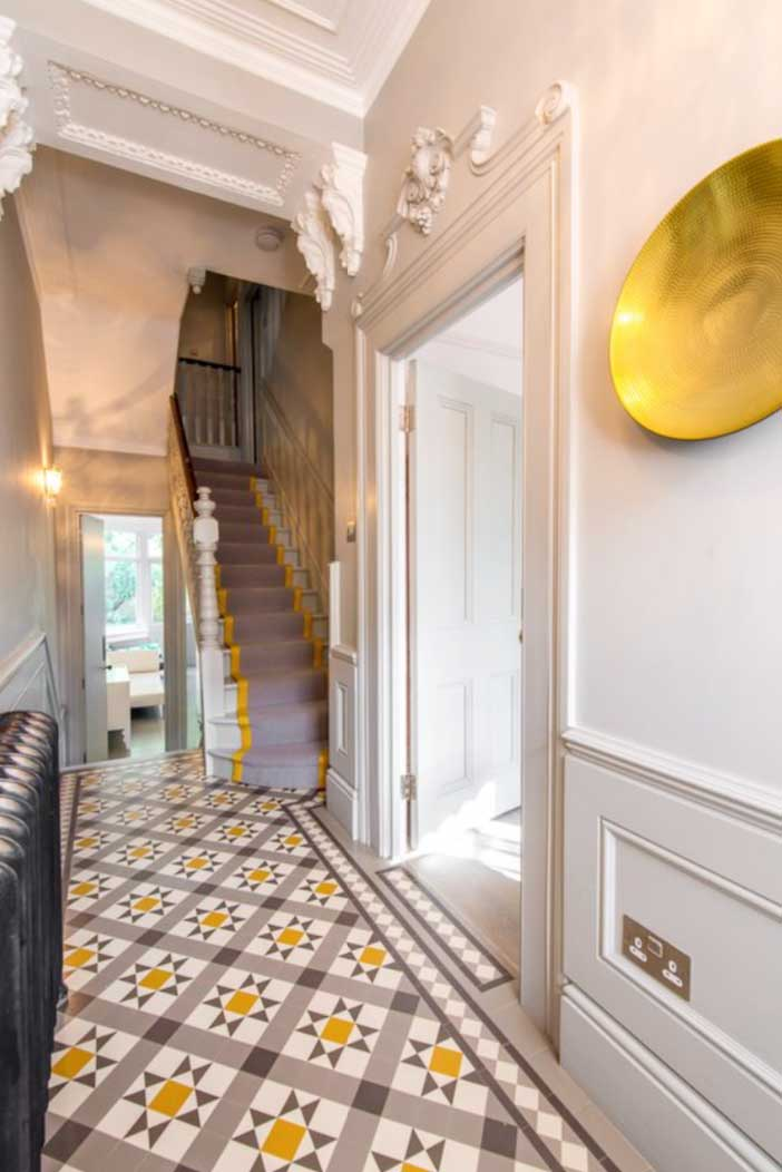 Image of a tiled period hallway used in a blog post by forthefloorandmore.com