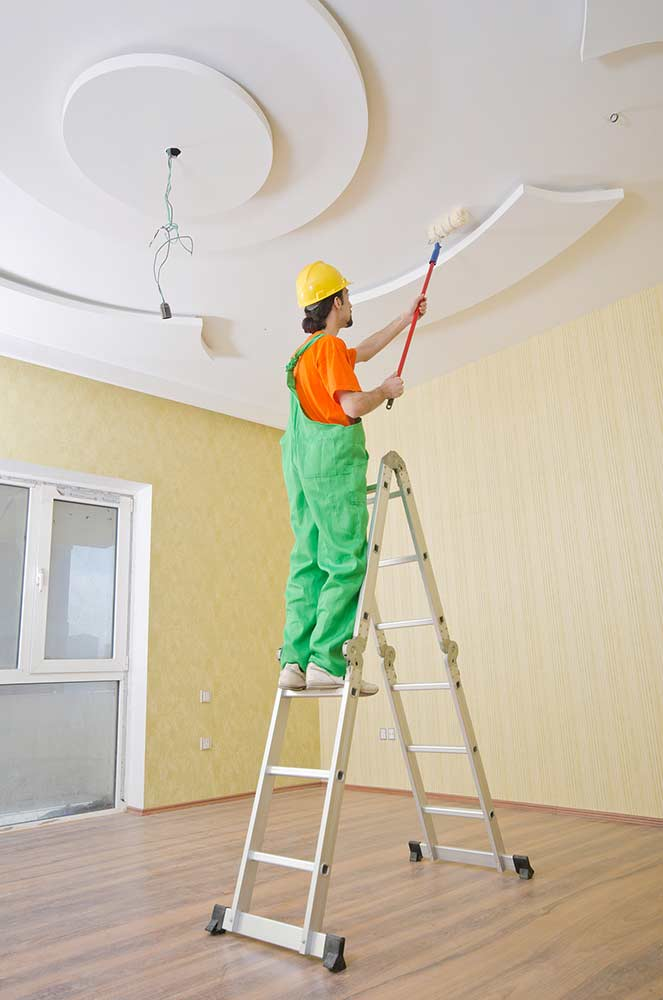 Image showing a ceiling being painted from a blog post about new year home decor by forthefloorandmore.com