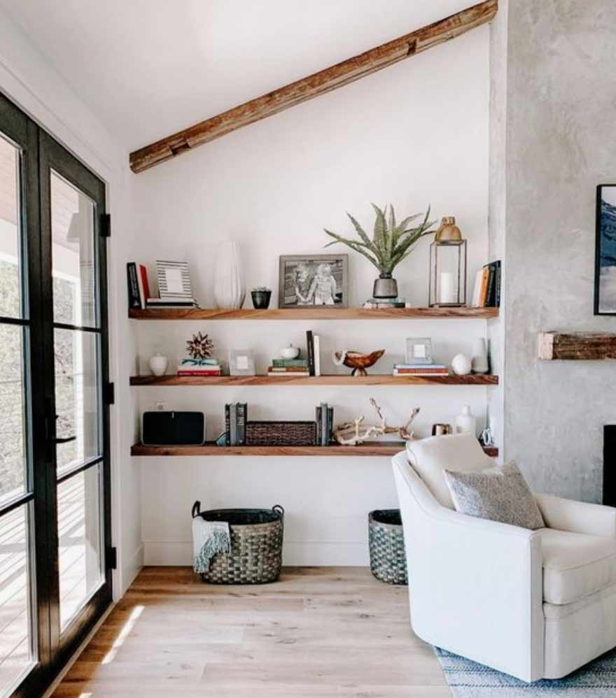 Image showing open shelving in the living room in a blog post by forthefloorandmore.com