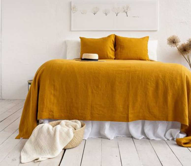 Image of a honey coloured bedcovers used in a blog post about honey coloured home decor for 2020 by forthefloorandmore.com