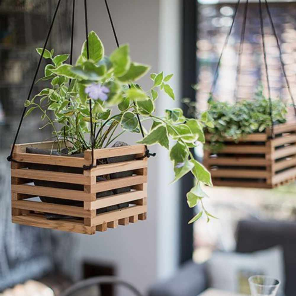 Image of hanging baskets used in a blog post about summer home decor ideas from For the Floor & More