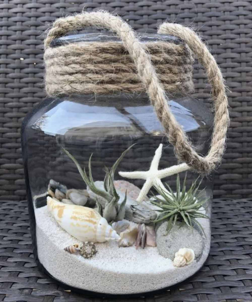 Image of a terrarium used in a blog post about summer home decor ideas from For the Floor & More