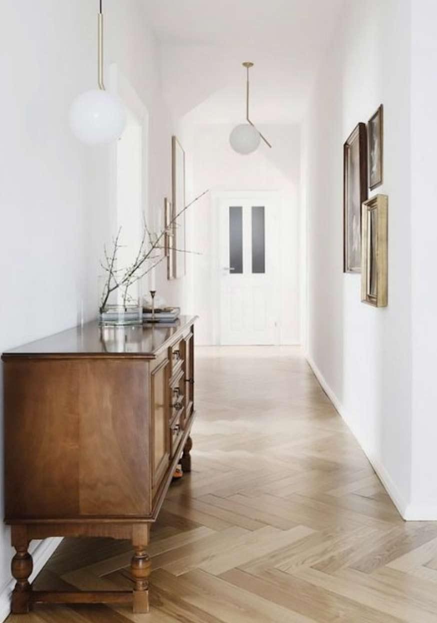 Image of a herringbone flooring installation used in a blog post by forthefloorandmore.com