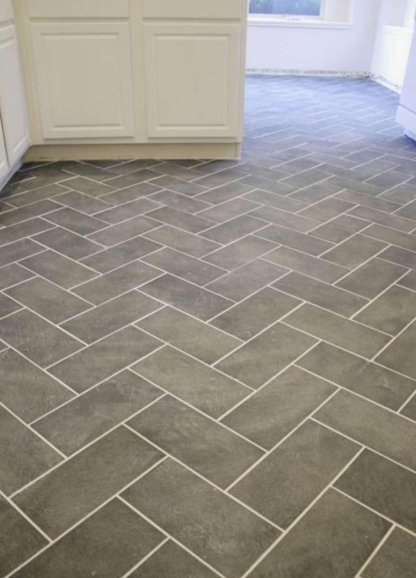 Image of a stone herringbone flooring installation used in a blog post by forthefloorandmore.com