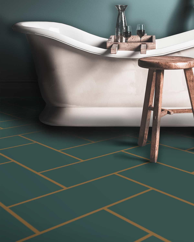 Image of a bespoke bathroom herringbone vinyl flooring only available from forthefloorandmore.com