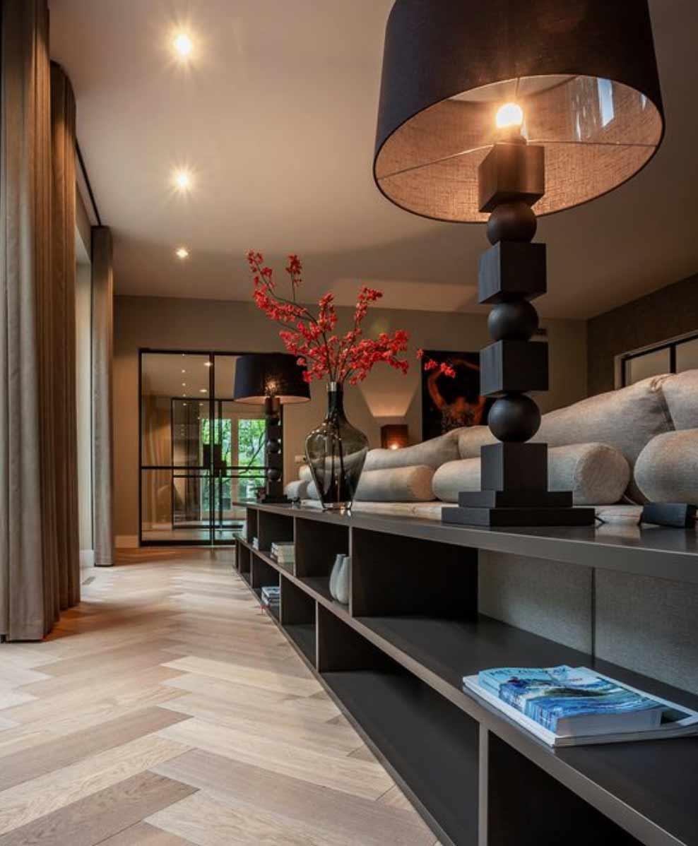 Image of an engineered herringbone lounge flooring installation used in a blog post by forthefloorandmore.com