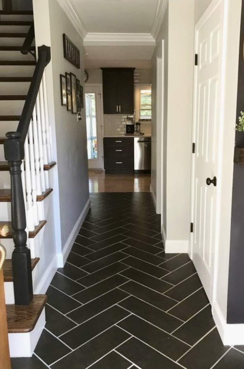 Image of a herringbone hallway flooring installation used in a blog post by forthefloorandmore.com