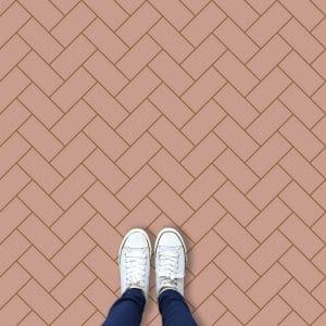Image of a bespoke pink herringbone vinyl flooring only available from forthefloorandmore.com