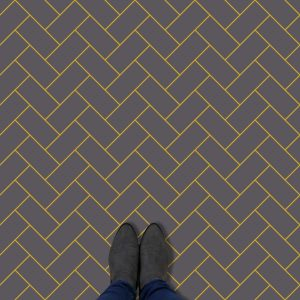 Image of a bespoke charcoal and mustard herringbone vinyl flooring only available from forthefloorandmore.com