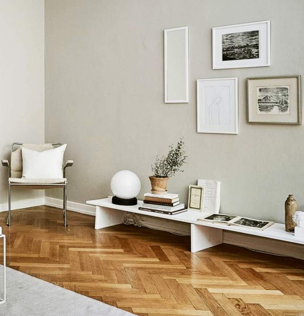 Image of a herringbone lounge flooring installation used in a blog post by forthefloorandmore.com